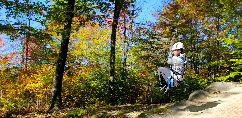 Girl Ziplining in the Fall